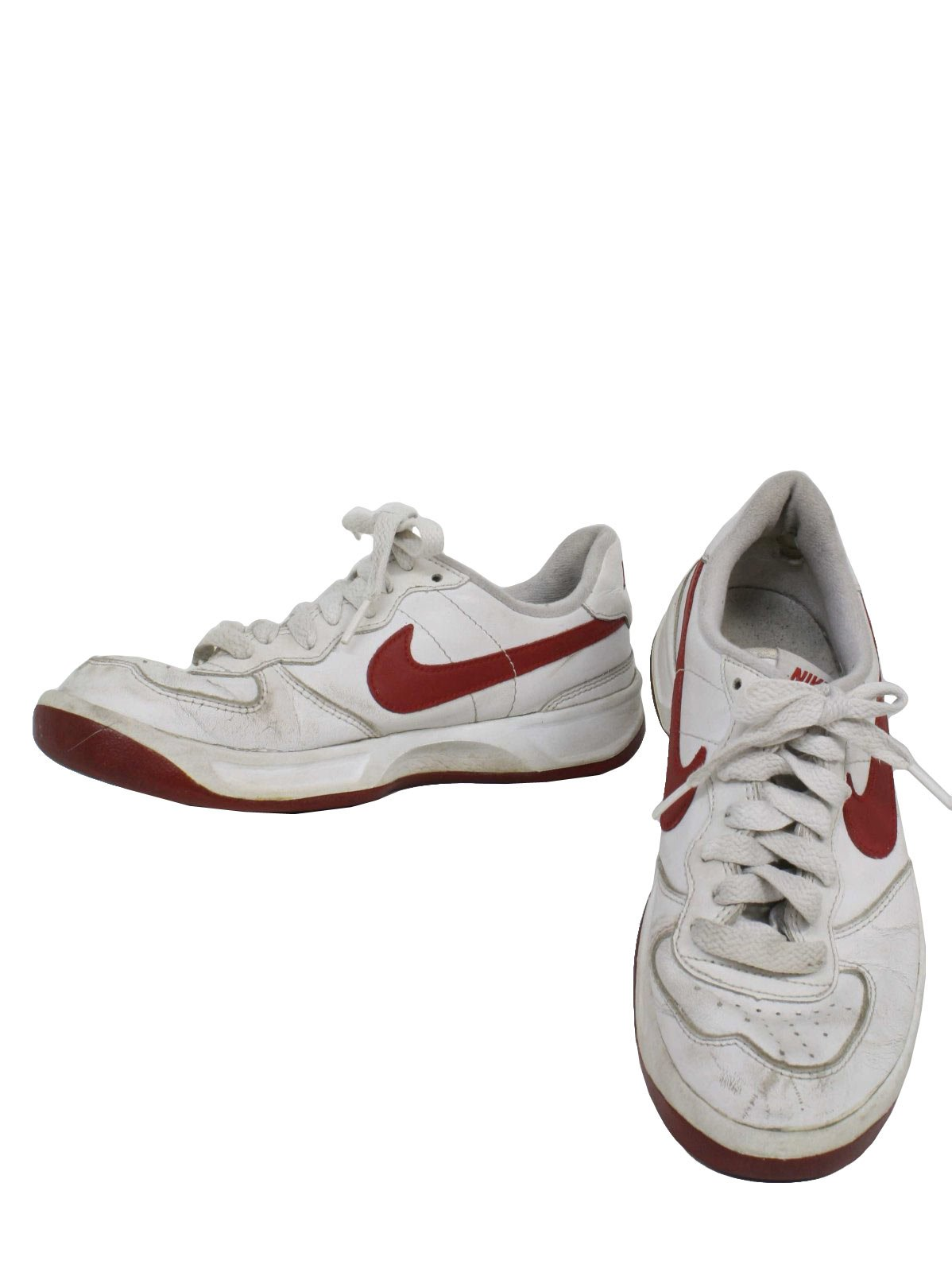 1990s Vintage Shoes: 90s -Nike- Mens white with red swoosh flat bottom old school style tennis shoes. Shoes show light wear but still have a long life to live. Would look awesome with a pair of baggy pants or short shorts.