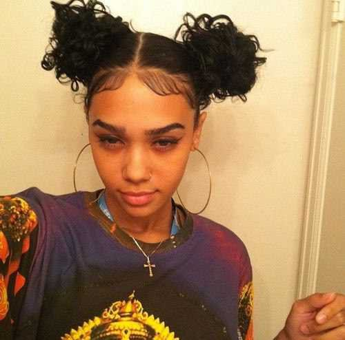 Double buns hairstyle with hair edges