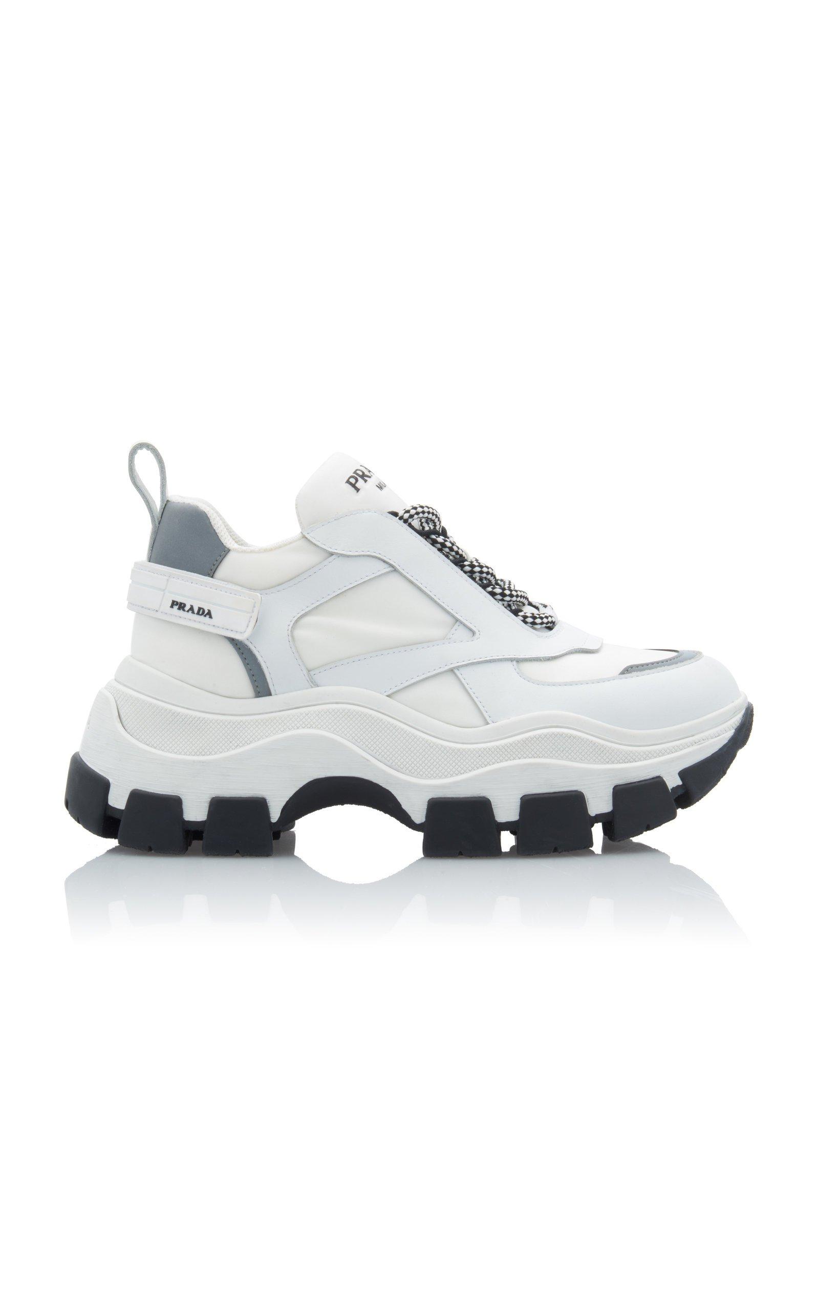Leather And Rubber Platform Sneakers by Prada | Moda Operandi