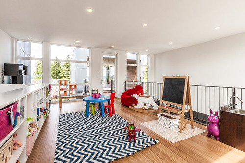 Wide Kids Play Room In The House With Appealing Childrens Chairs And White Shelves Near It
