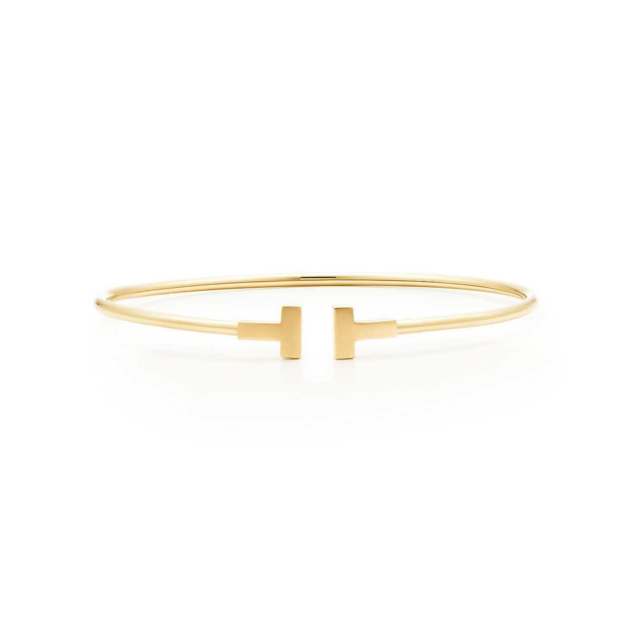 Tiffany T narrow wire bracelet in 18k gold, medium. | Tiffany & Co.