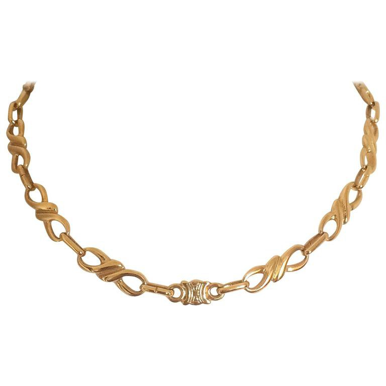 MINT. Vintage Celine golden twisted chain necklace with blaison macadam charm For Sale at 1stdibs