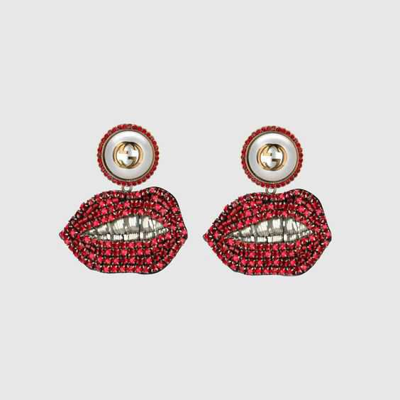 Gucci Earings  red lip mouths and glass pearls at the earlobe.