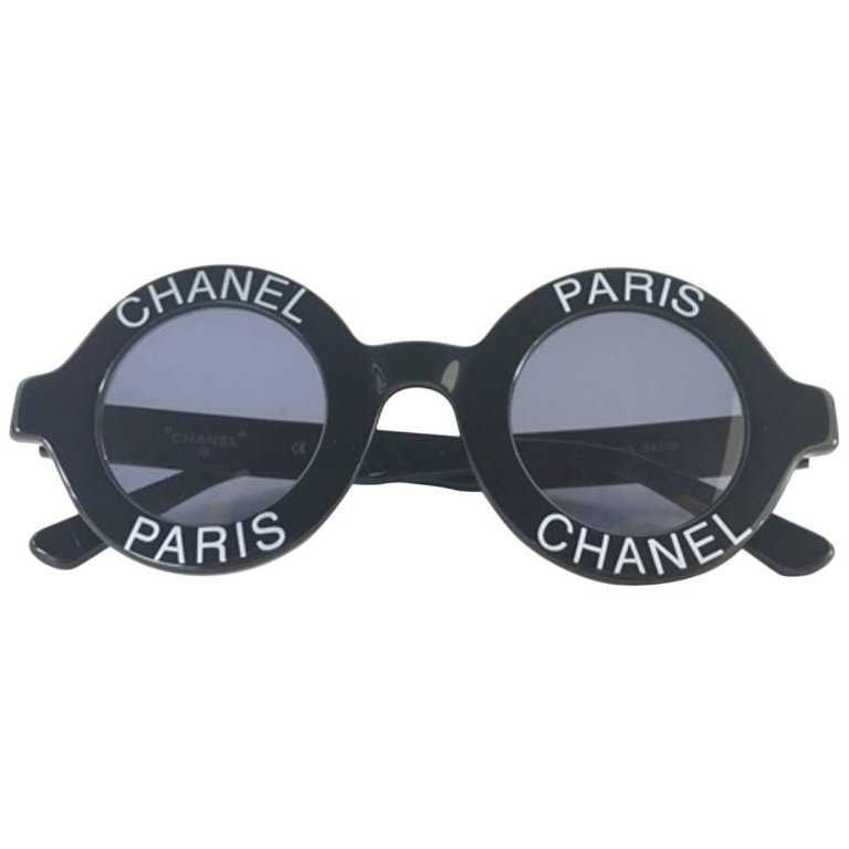 Chanel Vintage black round frame mod sunglasses with white CHANEL PARIS logo For Sale at 1stdibs