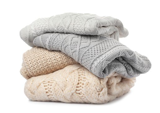 Stack of folded knitted sweaters