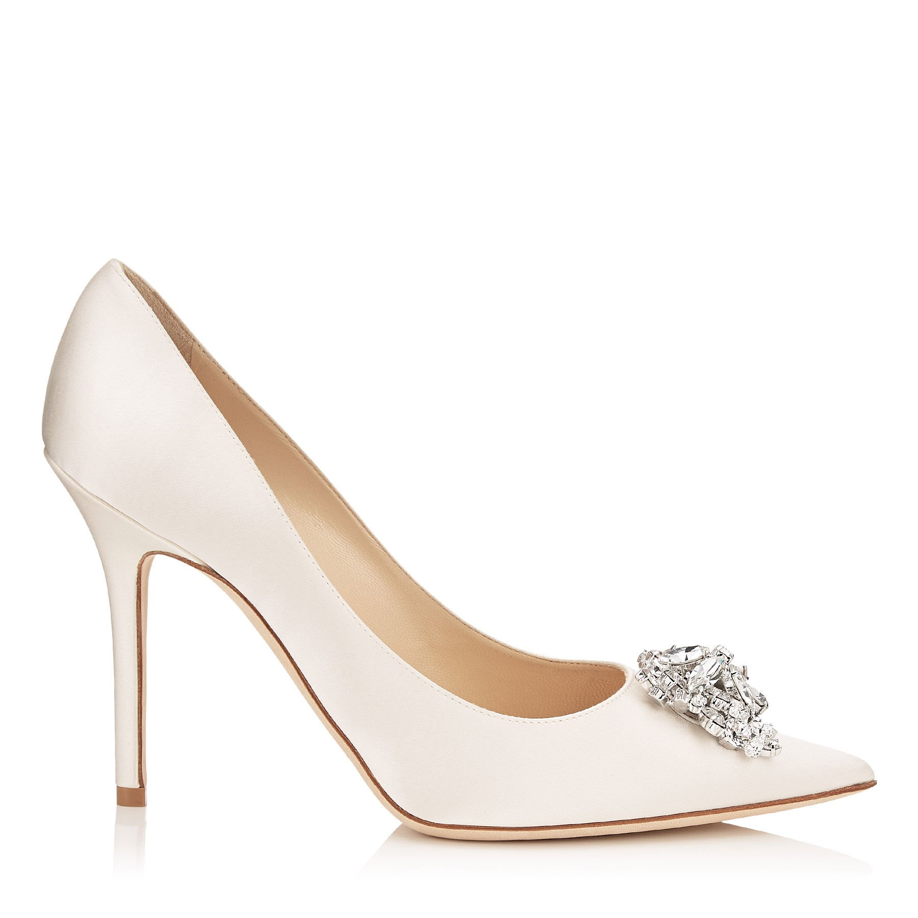 White pointed toe pumps with diamond