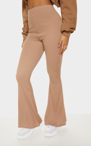 Camel Ribbed Flared Trouser | Trousers | PrettyLittleThing