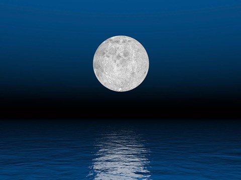 Framed Beautiful full moon against a deep blue sky over the ocean Print