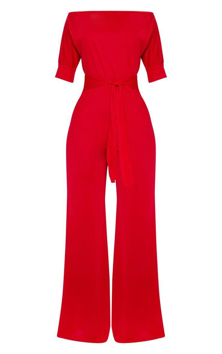 Red Off Shoulder Tie Waist Jumpsuit | PrettyLittleThing