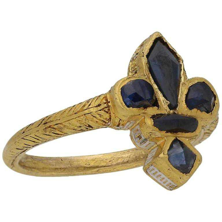 Post Medieval Sapphire Gold Fleur-de-Lis Ring, circa 16th Century For Sale at 1stdibs