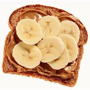 banana slices and peanut butter on wheat bread