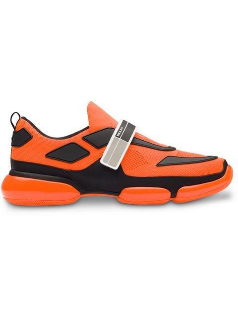 Prada orange Cloudbust neon sneakers