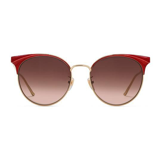 Round-frame metal sunglasses in Shiny gold guilloché metal frame with red enamel details | Gucci Women's Cat Eye
