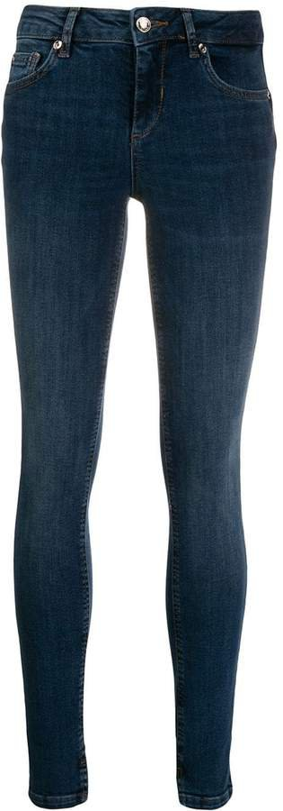 skinny jeans with ankle slits