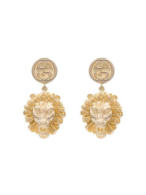 Gucci gold tone lion head earrings